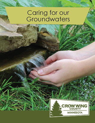 Brochure cover for caring for our groundwaters showing a person's cupped hands under a small waterfall
