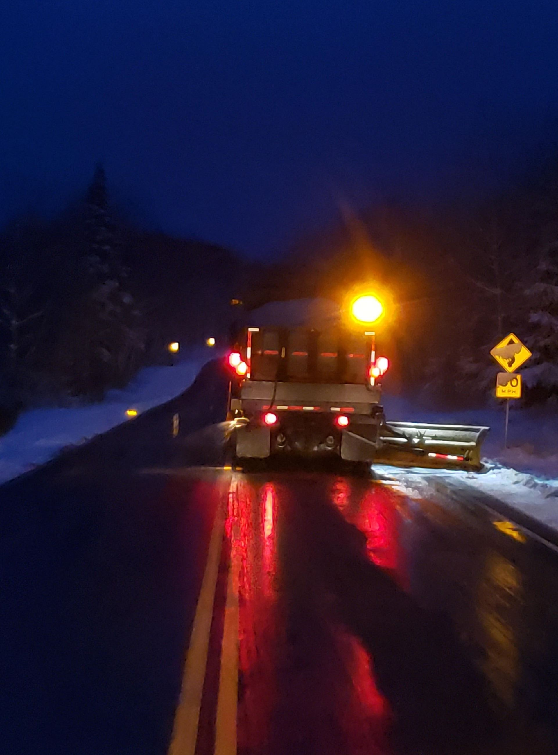 Snowplow driving in the dark